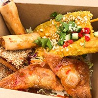Box to Go a sharing box for two of chicken satay, spring rolls, corn fritters, pork & sesame toast and pork wonton