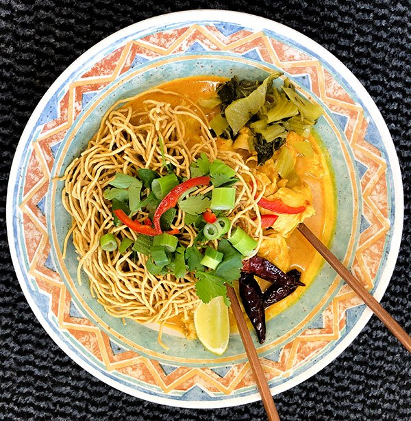 A bowl of Khao Soi Noodles at our Thai cafe in Kendal