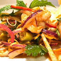 A plate of Pla Goong, a delicious Thai king prawn salad from our Khao Soi Cafe menu
