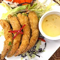 A plate of King Prawn Tempura with plum sauce dip at our Khao Soi Thai Cafe in Kendal