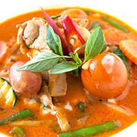 A dish of Red Curry with green bean, tomatoe and bamboo at our Khao Soi Thai Cafe in Kendal