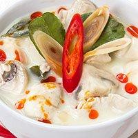 A bowl of Tom Kha Gai, Thai chicken soup at our Khao Soi Thai Cafe in Kendal