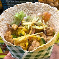 Thai Wrap chicken with satay sauce in a wrap of vegetables, and salad
