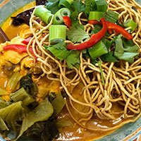 A bowl of Khao Soi, a noodle dish from northern Thailand at our Khao Soi Thai Cafe in Kendal