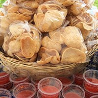 A basket of Thai prawn crackers with a sweet chilli dip