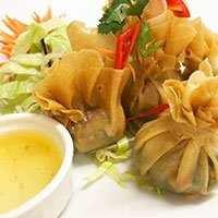 A plate of Tung Tong, Thai money bags with vegetables