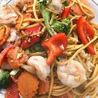 A plate of spaghetti kee mao talay mixed seafood with noodles